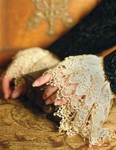 "VENETIAN LACE CUFFS ANTIQUE $24 Suddenly, sonnets spring to mind and one becomes in character with a heroine from an Elizabethan novel. Elasticized wrists are concealed beneath the season's sweaters and jackets. Antique, Black or Ivory. 6"". VTC Exclusive!"