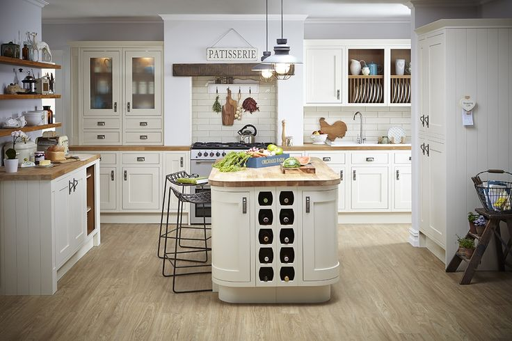 Neutral kitchens allow you to really showcase your unique personality. Bring your design to life with quirky signage, funky crockery displayed on shelving or industrial lighting and stools.