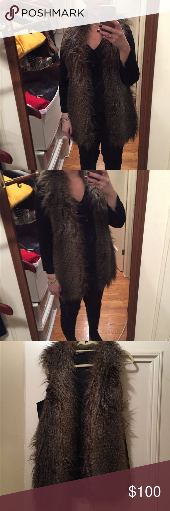 Black Halo Faux Fur Vest This vest is great! The longer length makes it slimming and warm. Plain back also gives a slimming effect so you don't look like a furry bear! Great color that can read brown or grey depending on what you paid it with. Black Halo Other