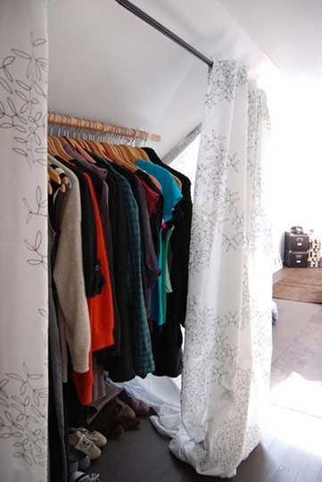 Take advantage of a slanted ceiling that might otherwise be useless by adding a closet rod and curtain... I wonder if this will be possible? If so, I think it might be ideal with no closet space!