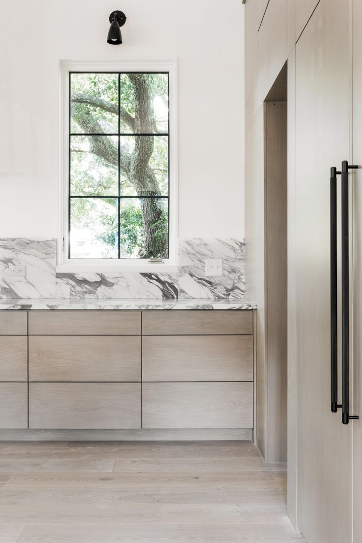 pale wood & marble in the kitchen,  by Cortney Bishop Design