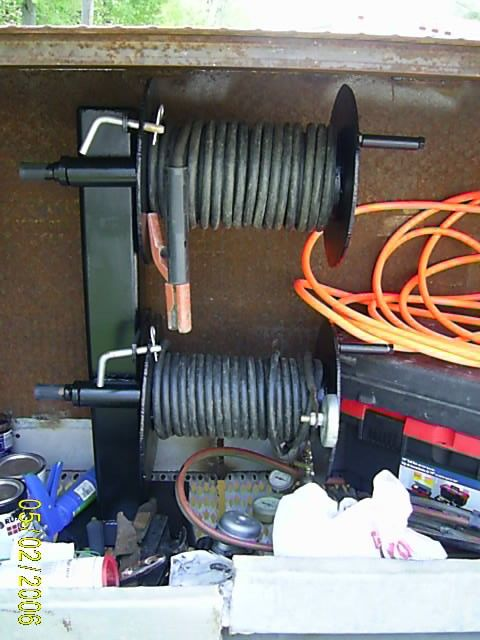 Welding Cable Reels by jksweld -- Homemade welding cable reels constructed from steel plate and pipe. Hitch pins inserted into the side plates prevent the cables from unrolling. http://www.homemadetools.net/homemade-welding-cable-reels