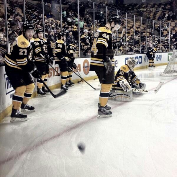 1/28/14 Dougie Hamilton is among the B's firing pucks off the glass pregame at TD Garden vs the FL Panthers.