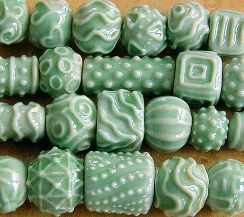 I'm trying to get this look with polymer. Joan Miller celadon beads  Hand formed beads, raised slip designs, celadon glaze