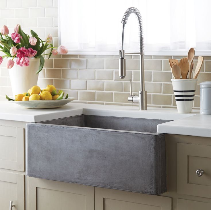 Modern concrete farmhouse sink maintains traditional apron front style