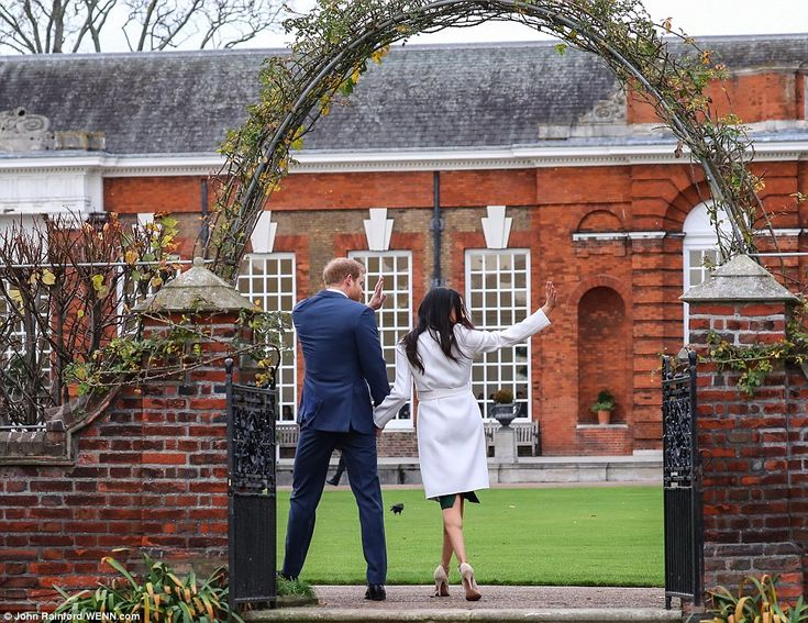"Running the show: 'It was interesting that Meghan was using little arm rubs with him and patting him,' says Judi. It was almost as though she was choreographing him to say, ""Right, we'll go up the steps and do some more pictures""'"
