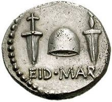 """Reverse side of a coin issued by Caesar's assassin Brutus in the fall of 42 BC, with the abbreviation EID MAR (Ides of March) under a """"cap of freedom"""" between two daggers"""