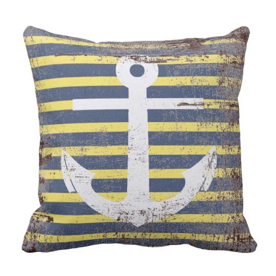 White anchor in striped background simulating aged throw pillow