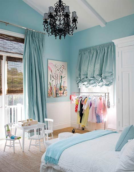 I love the idea of this pale blue bedroom for a little girl....This child is very good keeping her dress up clothes hung up.  I shudder to think what Annabelle's room would look like if we used this idea!  But the colors are really cute!
