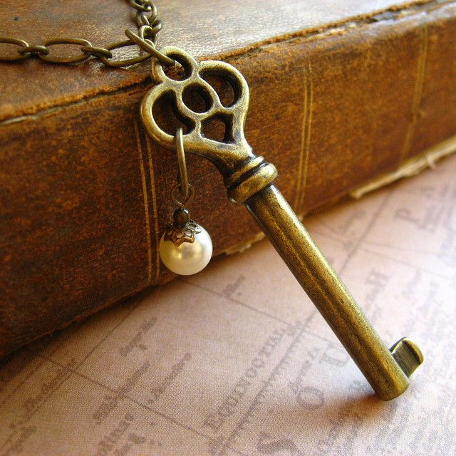 skeleton key necklace.. i have a bunch of these, i will def make one with a little charm too