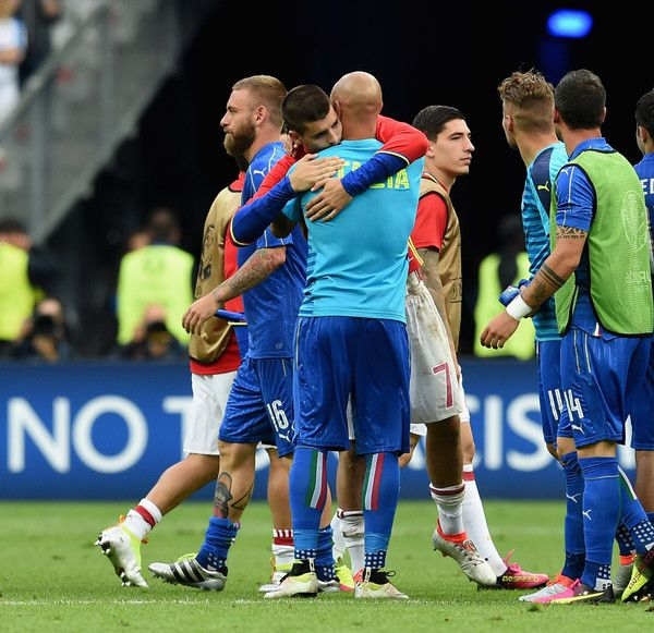 Alvaro Morata of Spain embraces Simone Zaza of Italy (R) at the end of the UEFA Euro 2016 Round of 16 match between Italy and Spain at Stade de France on June 27, 2016 in Paris, France.