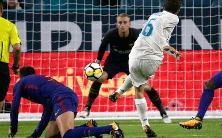 Real Madrid's Mateo Kovacic (16) scores past Barcelona goalkeeper Jasper Cillessen, center, during the first half of an International Champions Cup soccer match