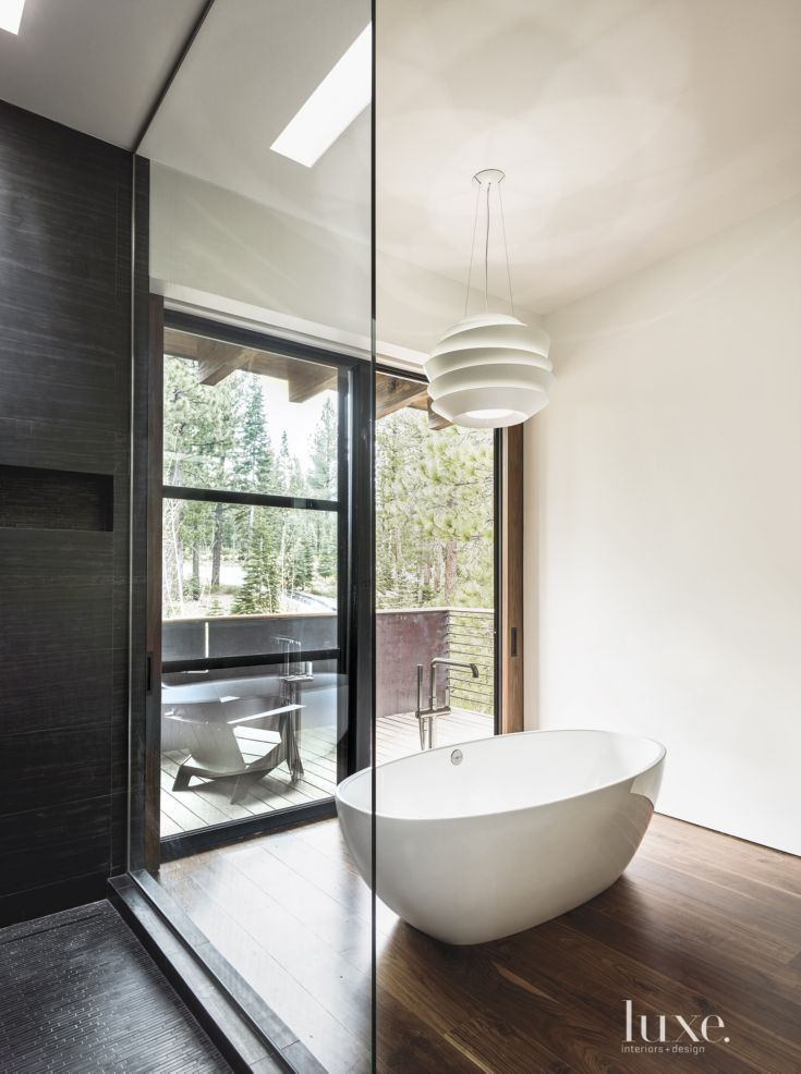 In Thi Master Bathroom A Le Soleil Suspension Lamp By Foscarini From Lightology Hovers Above