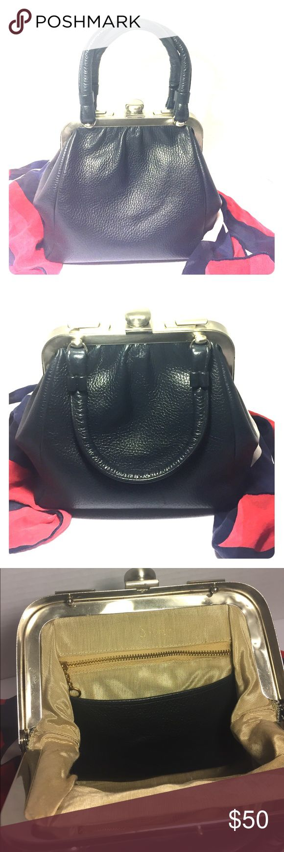 Saber navy leather vintage purse Navy pocketbook with silver tone hardware. Would look great with spectator shoe. 8 inches long, 81/2 inches tall, strap drop 41/2 inches, depth 3 inches. saber Bags