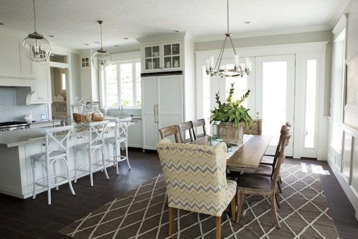 Use Wingback chairs in the dining room or kitchen. Davies Development - dining rooms - gray lattice rug, lattice rug, rectangular dining table, wood dining chairs. Light Gray walls, Thick White trim.
