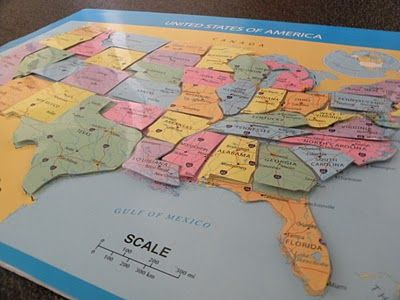 2 Dollar Store US maps with velcro states to stick on...pretty cool!