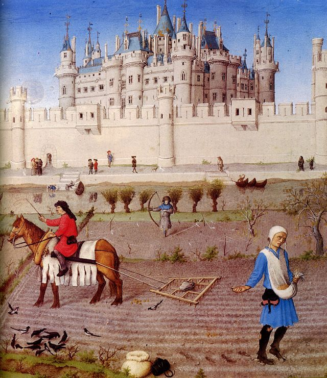 Les Très Riches Heures du duc de Berry octobre detail - Late Middle Ages - The peasants preparing the fields for the winter with a harrow and sowing for the winter grain. The background contains the Louvre, c. 1410