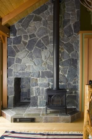 woodstove hearth - I really like this!  Love the wood cubby too!  Nice sized hearth.