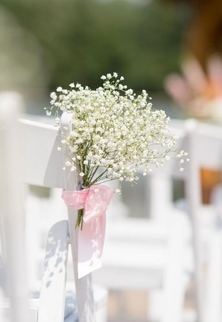 Rustic Romantic Outdoor Wedding - babys breath on wedding chairs