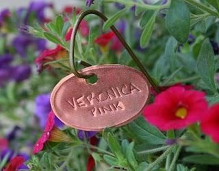 homemade garden tags using aluminum cans and hangers or copper sheeting