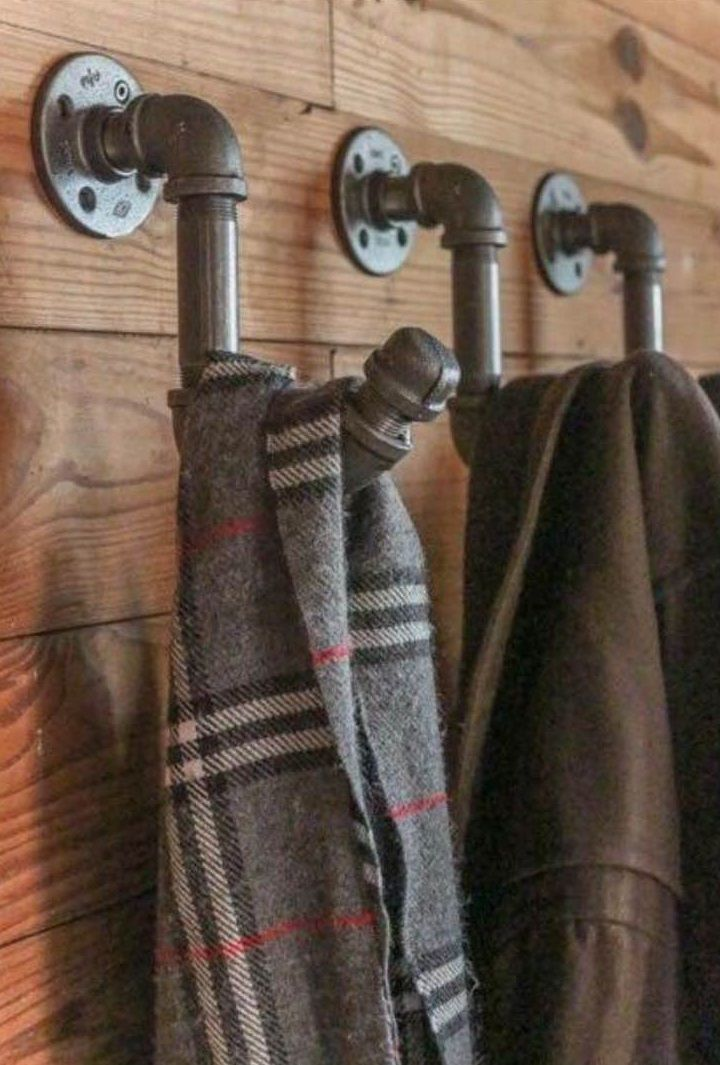 Coat/scarf hooks created using scaffolding pipes! Love this look http://www.morplan.com/shop/en/morplan/urban-retail-display-systems