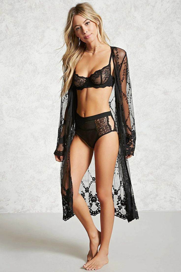 A sheer knit robe featuring an embroidered lace design, scalloped trim, an open-front, and long sleeves.
