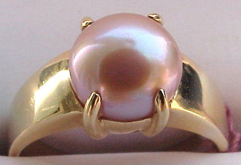 HEAVENLY GUMP'S PEARL RING: Softly pink pearl with great luminesce set in wide 14k yellow gold mount.