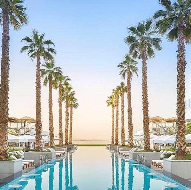 Right on the Palm, amazing pool view at the  Five Palm Jumeirah Dubai. Who would you take there? Pic by @fivepalm #mydubai #dubai #infinitypool #palmtrees #palmdubai #Hotel #Travel #Luxury #Pool #Resort