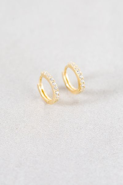 Classy small gold hoop earrings with pavé stones.