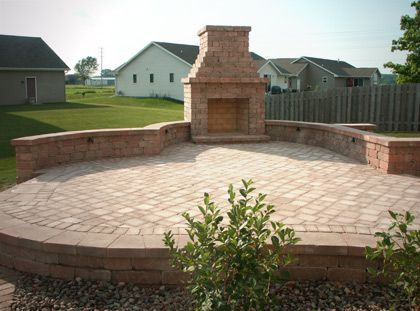 Outdoor fireplace elevated paver patio with outdoor for Fireplace on raised deck