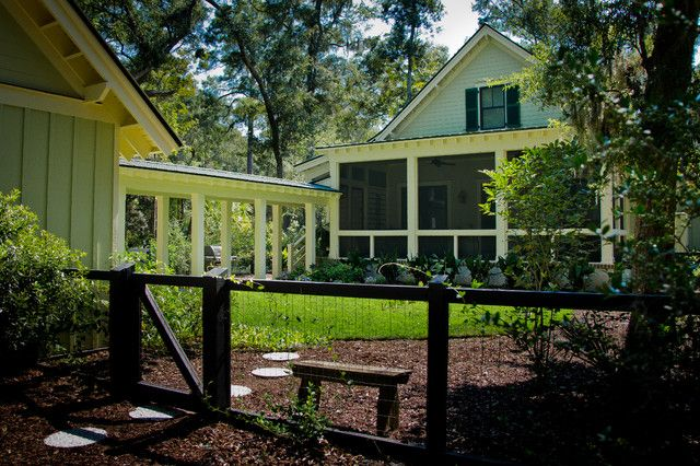 dog ear fence Exterior Farmhouse with breezeway farmhouse gable grass Landscape lawn lowcountry mulch neutral