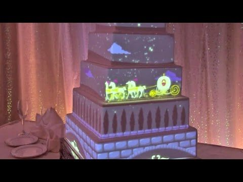 "VIDEO: Projection mapped wedding cake using projection mapping, Disney Imagineers made Cinderella's carriage glide across layers of a cake & Tinker Bell fly across it. The images projected onto the cake can feature your own photos/video.  Disney's weddings aren't cheap, but for those looking to make their special day a bit more magical, this new offering will definitely add that ""wow"" factor.  Cake mapping is currently available for Wishes Collection weddings @ Walt Disney World."