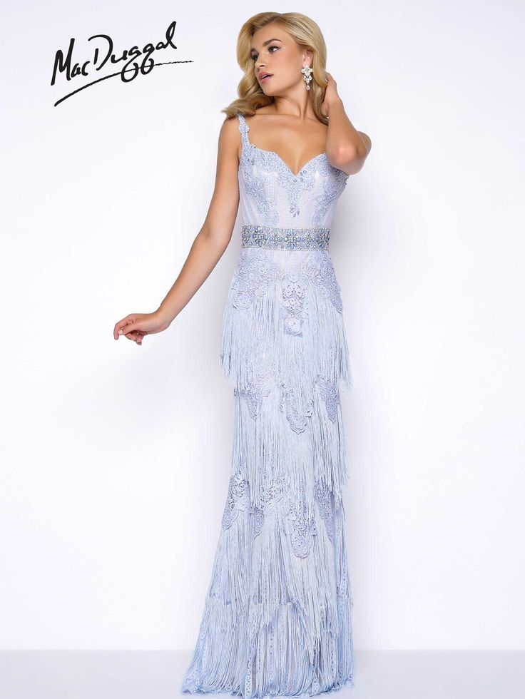 Lace, sleeveless, sweetheart beaded neckline, with beaded waistline and fringe skirt. This nontraditional high fashion prom dress is available in Blush and Ice Blue.