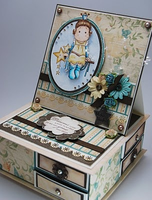Custom box with drawers and a card on top.