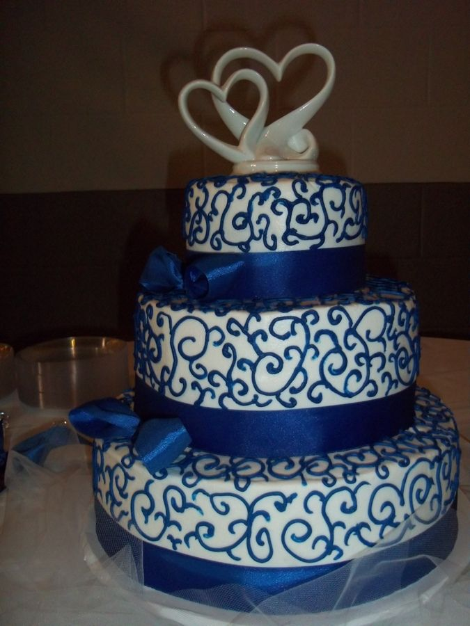 3 tiered white cake with buttercream icing, royal blue
