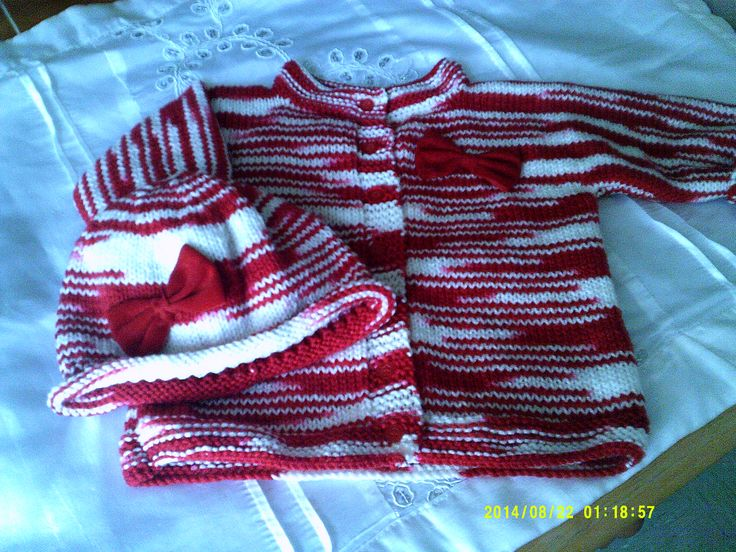 Red and white cardigan with matching hat with red velvet bows. Size 6 months - 1 year.