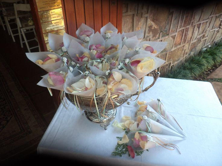 Rose-printed vellum with pastel ribbons to hold rose petal confetti