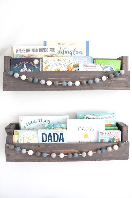 Nursery bookshelves and felt ball garland