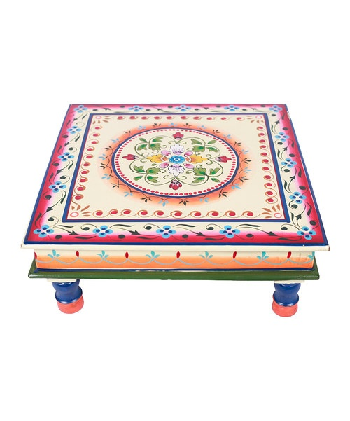 With intricate, geometric patterns and an eye-catching color, this handcrafted Bajot table features a low design and smooth surface that's perfect for snacks, games or displaying handsome ceramics and planters.15'' W x 6'' H x 15'' DWoodWipe cleanImported