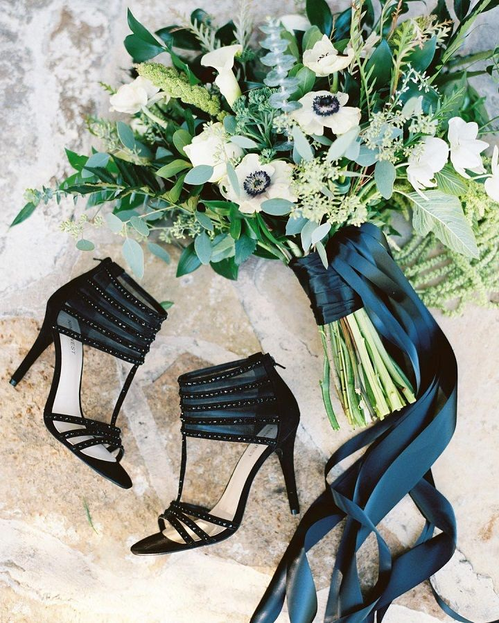 Black wedding heels + Anemones wedding bouquet wrapped with black ribbons #weddingshoes #sandals #ninewest #weddingheels #anemonesweddingbouquet #weddingbouquet