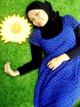 green grass, blue dress.