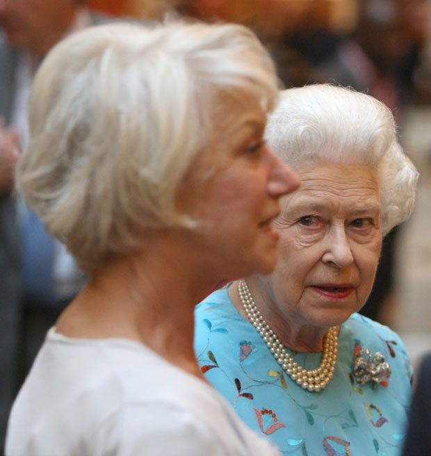 Queen Elizabeth looking at actress Helen Mirren during a reception to honour…