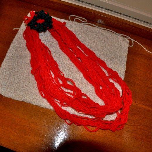 arm knitting neckace with mini wreath