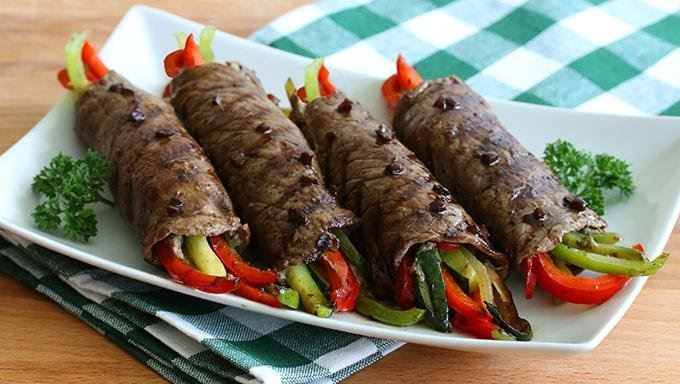 Sauteed peppers, onions, zucchini, and mushrooms are wrapped up with tender steak, grilled, then drizzled with a garlic, rosemary, balsamic vinegar glaze for a simple, delicious meal.