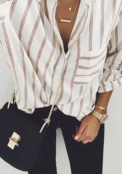 Top view of girl in a beige pinstriped button-down shirt and black pants