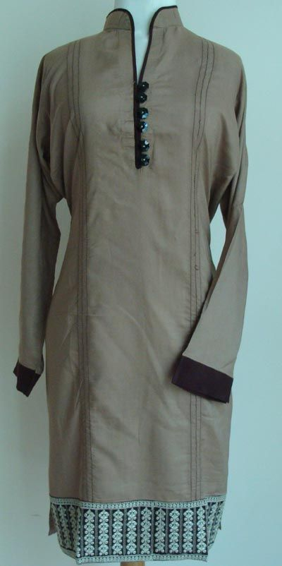 This is a very elegant and modest women's tunic top. The top has a very stylish cut with Chinese collars. The neckline has a very striking design with fancy buttons on the kurti.