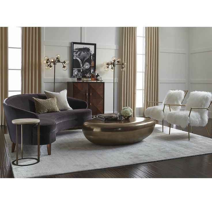 Our Vera sofa really gets around. Just look at the way she hugs the curves on that cocktail table.