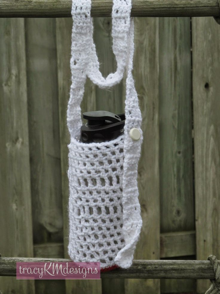 Extra large water bottle holder, white with red bottom.  Great for the huge bottles, or you can use it with a smaller bottle and have room to stuff your wallet or cellphone in too!  Fully adjustable strap, for cross body or one shoulder use.