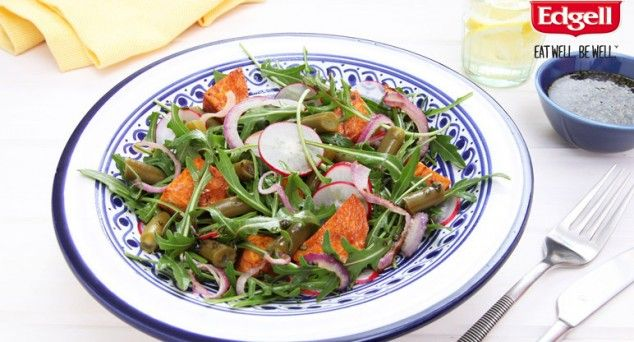 Warm roasted sweet potato salad, served on a bed of rocket.
