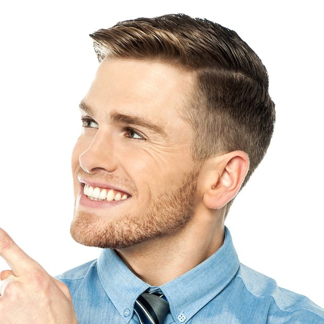 """For this style, the hair is tapered short around the sided and back and blended into about three inches of length on top.  To achieve shine and separation, a styling cream is used.  Like most classic tapered haircuts, this style could also be worn forward or even with more texture to create more casual, contemporary look."""